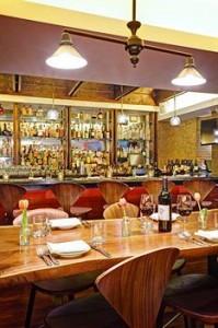 A Stocked Bar at Bread & Tulips Restaurant - Hotel Giraffe
