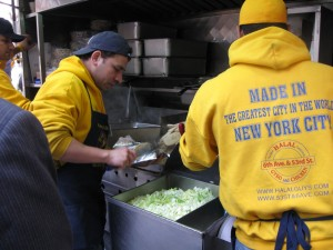 Men in Yellow Busy Making the Famous New York Chicken and Rice