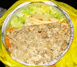 Salad Layer of Rice Topped with Shredded Chicken and Pita Bread - White Sauce Yet to be Added